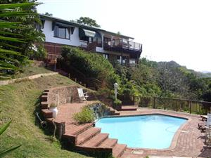 ON THE WATERS EDGE 2 SLEEPER VILLA IN IDYLLIC SETTING WITH SEA AND UMTENTWENI RIVER VIEWS FROM R200 P.P.P.N.