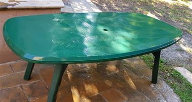 Outdoor 8 Seater Table and 5 chairs in good condition