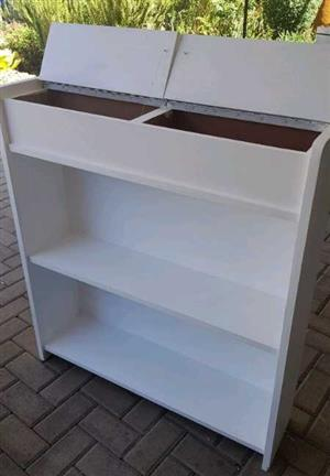 Bookshelf with storage boxes on top. Painted white
