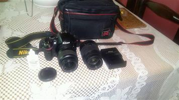 Nikon camera and seperate zoom lens 75-300mm for sale