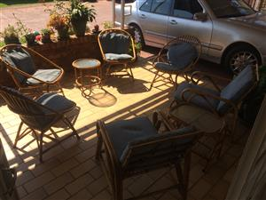 Six cane  chairs and two glass top tables