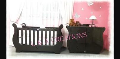 Sleigh cot and compactum
