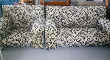 1 and 2 seater white floor couches