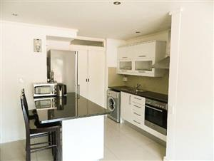 Apartment with rooftop pool and garage parking bay!