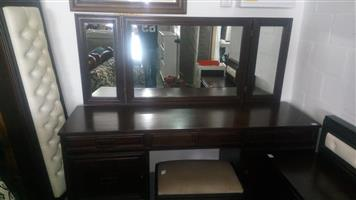 Dark wooden dresser with chair
