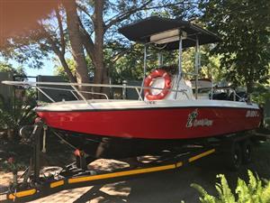 Xspression 600 centre console boat for sale