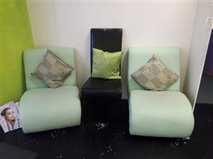 2 Light green chairs and 1 black chair