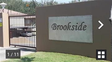 Ground unit to let in popular Brookside Complex.Garsfontein.  Stunning,modern, 2 bed, 1 bath, open plan kitchen/lounge /patio.Braai facilities in complex
