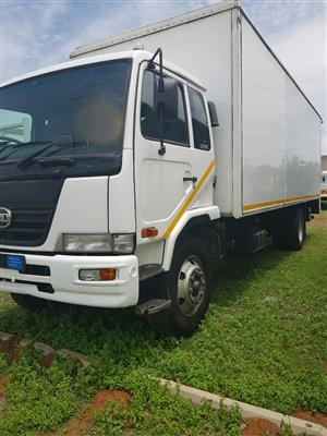 2013 Nissan UD90 Automatic, closed body truck with a tail lift for sale