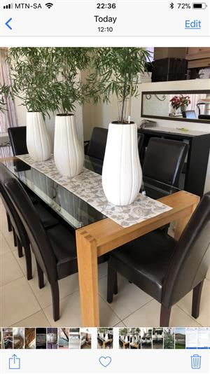 Dining room table and chairs for sale.