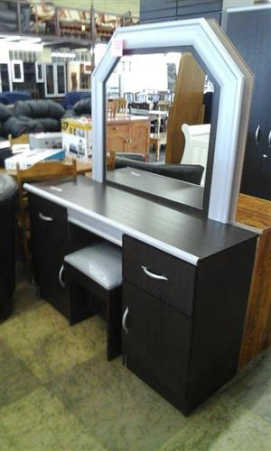 Dark wooden and silver dresser with mirror and drawers