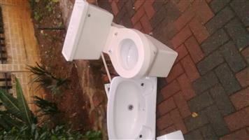Used Bath basin toilet shower complete and 3 soap dishes used