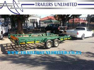 TRAILERS UNLIMITED.  DOUBLE AXLE CAR TRAILER. SLIDE IN RAMPS.