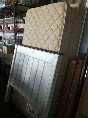 White single headboard and single mattresses