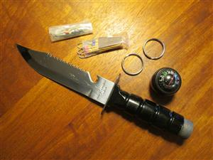 Collectable survival knife (all metal) from 1986 in excellent condition, with original content, line saw, matches, hooks, fishing line, compass, etc.