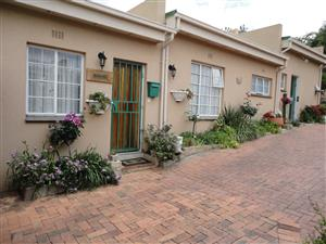 Neat furnished 1 bedroom garden cottage in secure property