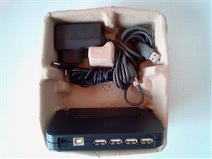 USB  2.0 4-port Hub Belkin F5U224. With adapter and  USB A to B cable.