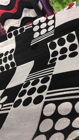 Black and white circle,square and stripe pattern carpet