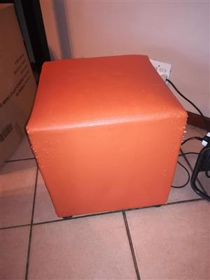 Orange leather ottoman for sale