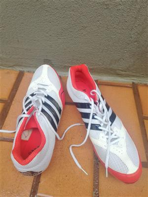 Adidas White and Red Athletic Spikes