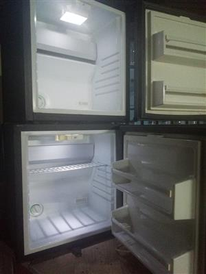 2mjni bar fridge goes on but not making cold 2for both