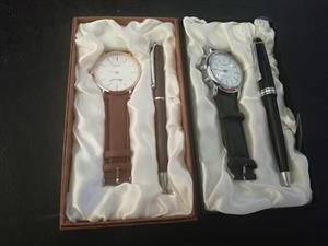 Brown and black watch and pen sets