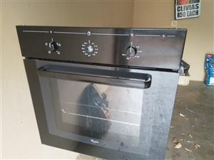 Oven, hob and extractor.