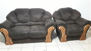 Used 2 two seaters and 2singles arm cushioned with wood carving,comfortable clean,neat,chocolate brown lounge set in good condition