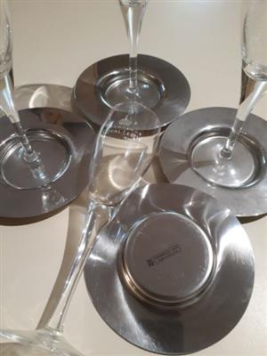 4 champagne flutes and WMF silver coasters