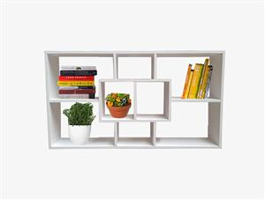 White book and plant shelf