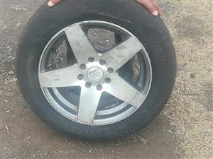 Mag wheels 14 inch with tyres this is 4 rims
