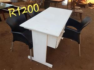 White desk and 3 black chairs