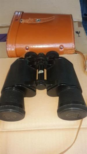 pair of 16x 50 Binoculars in leather carry case with lens covers