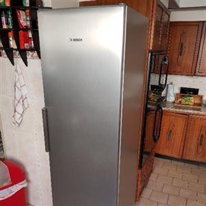 Silver Bosch upright fridge and freezer