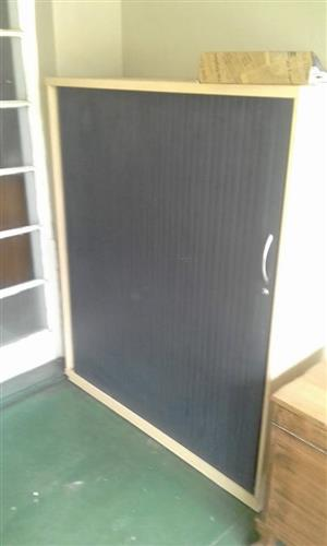 Large beige and black sliding door cabinet