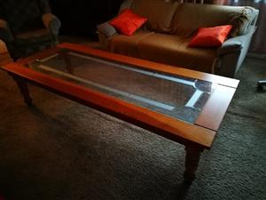 Glass top coffee table for sale.