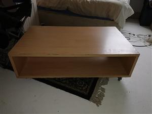 Coffee table on wheels for sale.