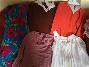 Assortment of woman's plus sized clothing.