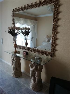 2 statues with glass top mirror and frame
