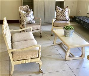 Seating set. Wood. One double and three single seater. New upholstery