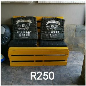 Yellow bench with black cushions