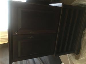 Dark wood bar stand with wine rack