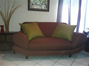 1 x 2-seater and 1 x 3-seater chocolate brown lounge suite.