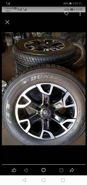 """18""""Toyota Legend 50 mag wheels and 265/60/18 Dunlop At tyres for r13000."""