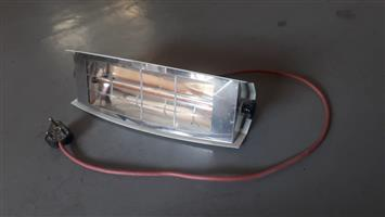 Tecknilamp electric tube heater. With bracket for mounting.Very good condition. 1500W. Very hot.