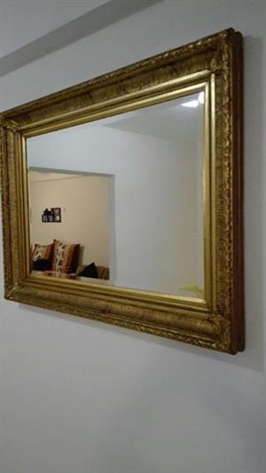 Large golden framed mirror