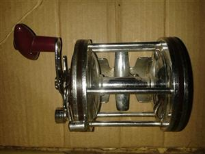 Red handle silver fishing reel