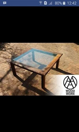 Square imbuia/glass coffee table for sale.