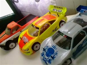 5 x sakura zero scale racing cars for sale , PLENTY spares of batteries,tyres,shocks, and accessories