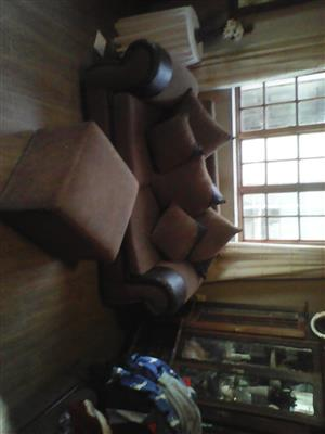 2X double seater with 5X scatter cushions plus ottiman.Fair condition.R2250.